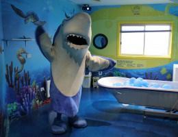 SEA LIFE Melbourne Aquarium Mascot Sharkie enjoying the new underwaterbathroom at Very Special Kids
