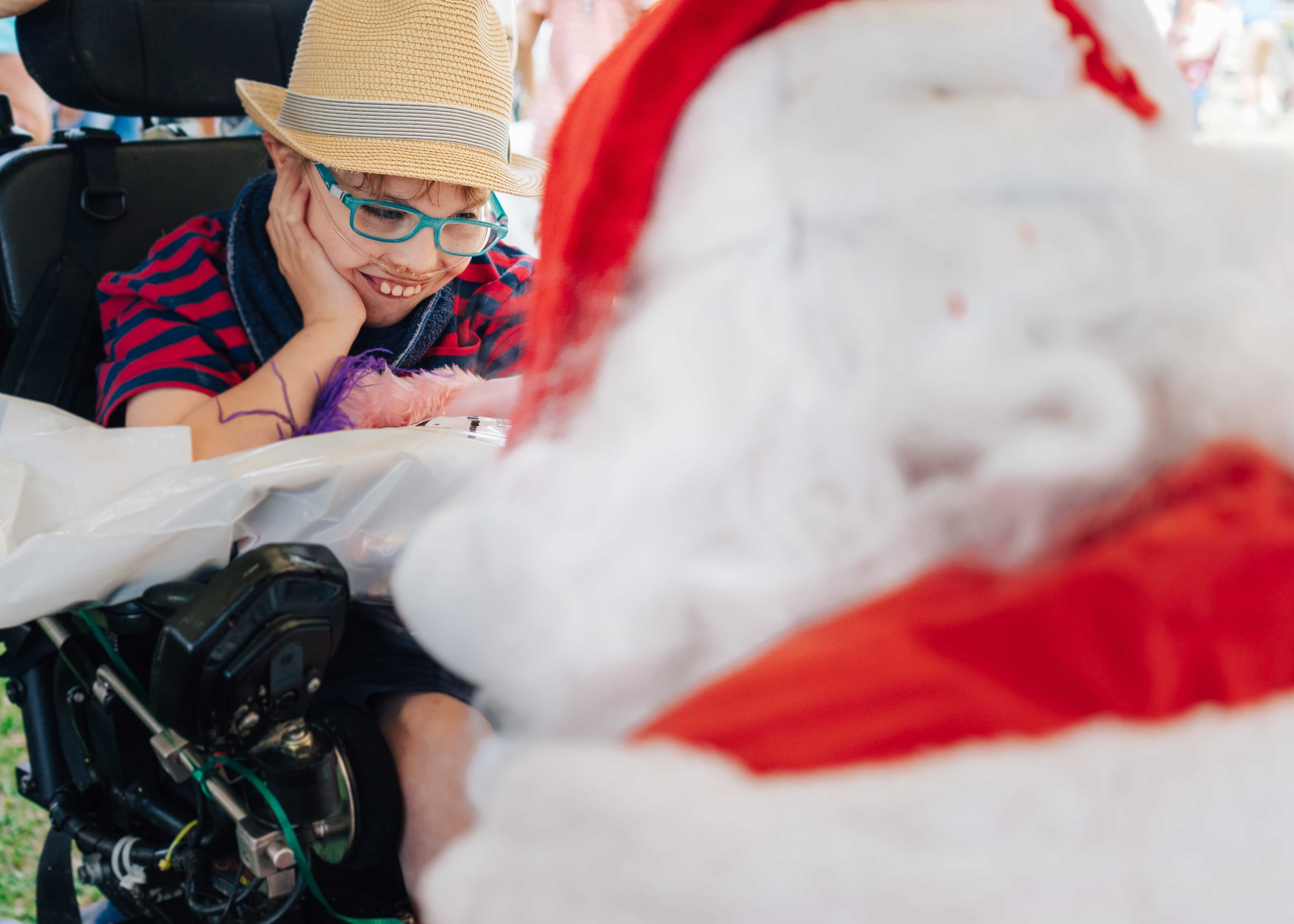 Elias Anderson enjoys visiting Santa.